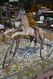 Sale 8093 - Lot 1832 - Antique Childs Pedal Horse with Hand Crank and Leather Saddle