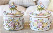 Sale 8250 - Lot 50 - A Pair of Meissen Style Lidded Boxes and Covers , each modelled with drop in lids, and applied flower heads