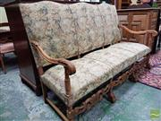 Sale 8485 - Lot 1044 - Louis XIV Style Beech High Back Settee, upholstered in a garden pattern damask, with carved legs & stretcher base