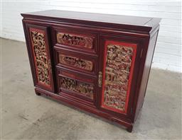 Sale 9162 - Lot 1070 - Chinese Rosewood Sideboard, with two doors & three drawers, inset with red lacquer & carved gilt figural panels (h:95 x w:121 x d:46cm)