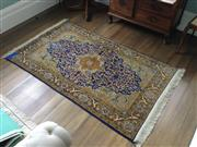 Sale 8048A - Lot 80 - Hand Knotted Persian rug, central blue medallion with repeating border pattern on yellow ground, 103 x 170cm