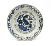 Sale 8844 - Lot 82 - A C17th Chinese saucer dish decorated with a ho ho bird, diameter 18.5cm. Late Ming. (fritting)