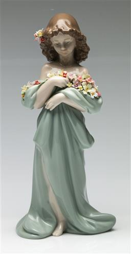 Sale 9209V - Lot 65 - A Lladro figure of a girl with flowers (H: 26cm)
