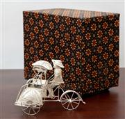 Sale 8774A - Lot 344 - A filigree silver rickshaw in a glass case with fabric covered box, H x 7cm