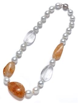 Sale 9083 - Lot 504 - A SOUTH SEA PEARL AND QUARTZ NECKLACE; graduated 12-14mm baroque cultured pearls of good colour and lustre and 2 rock crystal and 3...