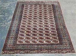 Sale 9179 - Lot 1007 - Royal Bokhara Wool Carpet, with six columns of Turkoman guls on a grid pattern, on cream field (some loss to ends,  310 x 243 cm)