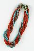 Sale 3701 - Lot 429 - AN ELEVEN STRAND CORAL AND TURQUOISE BEAD NECKLACE;