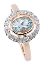 Sale 9037 - Lot 378 - AN AQUAMARINE AND DIAMOND RING; rub set with an approx. 0.70ct oval aquamarine to a surround of 24 round brilliant cut diamonds in 9...