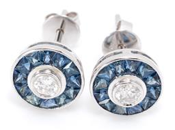 Sale 9209J - Lot 392 - A PAIR OF 18CT WHITE GOLD SAPPHIRE AND DIAMOND STUD EARRINGS; each centring a round brilliant cut diamond surrounded by 12 trapezoid...