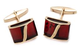 Sale 9186 - Lot 379 - A PAIR OF 14CT GOLD AMBER CUFF LINKS; set with curved amber plaques, top 15 x 11.5mm, wt. 6.47g.