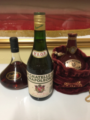 Sale 8677B - Lot 989 - Three bottles of assorted spirits, rum, brandy and scotch whiskey in a velvet pouch