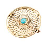 Sale 8857 - Lot 484 - A VINTAGE 14CT GOLD STONE SET BROOCH; lattice work disc brooch centring a cabochon turquoise, diam. 30.5mm, wt, 4.79g.