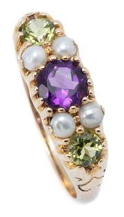 Sale 9037 - Lot 370 - A SUFFRAGETTE INSPIRED GEMSTONE RING; belcher set with 2 round cut peridots, 4 seed pearls to a central round cut amethyst in 9ct go...
