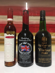 Sale 8677B - Lot 990 - Two bottles of Port including a celebration 1981 royal wedding and a Hardys vintage together with a bottle of Miranda Botrytis desse...