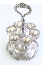 Sale 8977 - Lot 96 - A Set of 6 Silver Plated Egg Coddlers on Stand (H 30cm)
