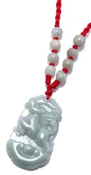 Sale 9046 - Lot 594 - A JADE PENDANT NECKLACE; 37 x 23mm plaque depicting a prancing horse on a plaited red silk cord strung with 8 jade beads.