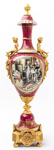 Sale 9083N - Lot 29 - A Sevres style porcelain urn with gilt bronze handles, pedestal and finial, cartouches painted with musicians, nymphs and putti H:74cm