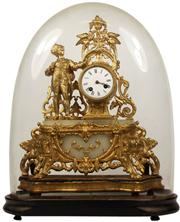 Sale 8065 - Lot 38 - French 19th Century Gilded Prince Charming Figural Glass Domed Clock