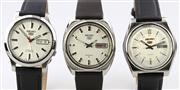 Sale 8644W - Lot 73 - THREE SEIKO 5 AUTOMATIC WRISTWATCHES; in stainless steel with applied markers, center seconds, day date, one with transparen beck, n...