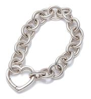 Sale 8999 - Lot 392 - A SILVER BRACELET; 12mm wide cable link chain to open heart clasp, with fake Tiffany marks, length 18cm, wt. 45.03g.
