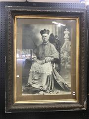 Sale 9014 - Lot 1004 - Late 19th Century Large Photograph Portrait, of a either a Bishop or Cardinal seated, within a tied wreath frame with gilt slip
