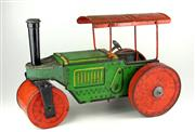Sale 8330T - Lot 2 - English Tinplate Clockwork Steam Roller; in green and red marked Made in Gt Britain, some pitting to roof, not working.