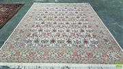 Sale 8359 - Lot 1073 - A Fine Indian Jaipur Wool Carpet with repeating pattern of vases and cornucopia of flowers on a cream field (282x373)(Ex Cadrys)