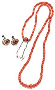 Sale 9083 - Lot 518 - A GRADUATED CORAL BEAD NECKLACE WITH EARRINGS; 3.6 - 7.3mm round salmon colour beads to a coral bead set clasp with safety chain len...