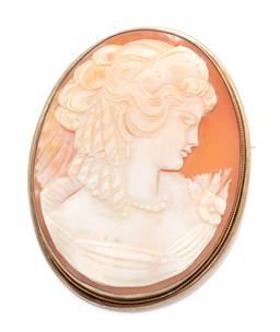Sale 9260H - Lot 364 - A vintage silver gilt cameo brooch; oval carved shell cameo portrait, size 54 x 42mm, wt. 16.12g.