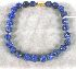 Sale 3682 - Lot 542 - A CARVED LAPIS BEAD NECKLACE.