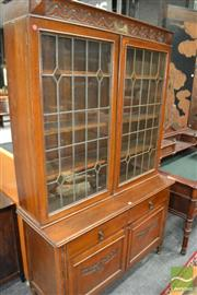 Sale 8460 - Lot 1001 - Art Deco Oak Bookcase, with two leadlight panel doors, above two drawers, two carved panel doors & turned legs