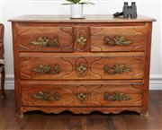 Sale 8838H - Lot 75 - A late C18th French provincial beech and walnut commode with two short and two long drawers with gilt bronze handles above the shape...