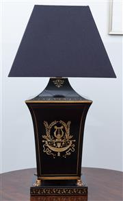 Sale 9005H - Lot 82 - A French empire style toleware table lamp with musical motifs on lion paw feet to square base and black shade, Total Height 66cm