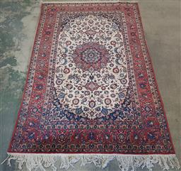 Sale 9179 - Lot 1019 - Good Persian Wool Carpet, with red medallion & pendants on cream field with arabesques, in red & blue tones (337 x 210cm)