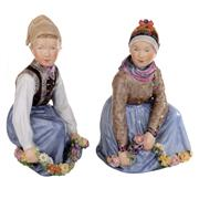 Sale 8000 - Lot 17 - A pair of Royal Copenhagen figures titled Amager and Fano designed by Carl Martin-Hansen, 1906-1925.