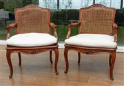 Sale 8838H - Lot 31 - A set of six C19th French Louis  XV style stained beech fauteuils, each with caned back and seat and upholstered loose squab cushion...
