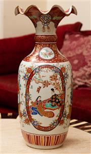 Sale 8882H - Lot 48 - An antique Japanese export ware porcelain vase with alternating court scenes and baskets of flowers, restorations to rim, Height 55cm