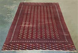 Sale 9179 - Lot 1060 - Bokhara Wool Carpet, with nine dense columns of guls, on deep red ground & comb ends - some areas of wear (389 x 282cm)