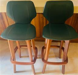 Sale 9155H - Lot 105 - A pair of blackwood raised and green leather upholstered bar stools. Height of back 101cm, Purchased at Buckleys Oct 1999