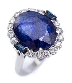 Sale 9194 - Lot 392 - AN 18CT WHITE GOLD SAPPHIRE AND DIAMOND RING; centring an oval cut glass treated blue sapphire to surround set with 2 baguette cut s...