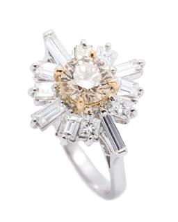 Sale 9253J - Lot 412 - AN 18CT WHITE GOLD DIAMOND STARBURST RING; centring a round brilliant cut champagne diamond of approx. 0.90ct P1 to surround of 4 pr...