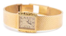 Sale 9260H - Lot 360 - An 18ct gold Girard Perrigaux ladys manual wristwatch; rectangular textured gold dial with baton markers on a Girard Perrigaux 17 j...