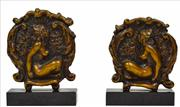 Sale 8309 - Lot 536 - Norman Lindsay (1878 - 1969) - Pair of Bookends c.1930 20.5 (h) x 14.5 (w) x 5.0cm (d)