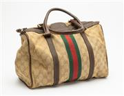 Sale 8661F - Lot 16 - A vintage Gucci canvas bag with brown leather trim H 26 x W 21