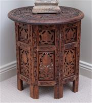 Sale 9005H - Lot 86 - An Indian heavily carved circular top occasional table with hinged base,  Height 40cm x Diameter 38cm