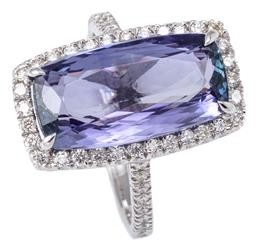 Sale 9253J - Lot 441 - AN 18CT WHITE GOLD TANZANITE AND DIAMOND RING; centring a modified radiant cut tanzanite of approx. 6.20ct to surround and shoulders...