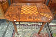 Sale 8255 - Lot 1019 - Specimen Games Table, the later marquetry top with chess board & scribbage, raised on earlier turned legs