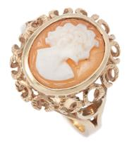 Sale 9037 - Lot 331 - A 9CT GOLD CAMEO RING; 12 x 10mm carved shell cameo featuring a portrait on a swirl gallery to split shoulders, size O, wt. 4.38g.