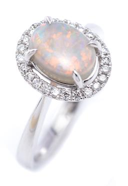 Sale 9194 - Lot 553 - AN 18CT WHITE GOLD OPAL AND DIAMOND RING; centring an oval cut opal to surround set with 26 round brilliant cut diamonds, top 12 x 1...