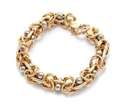 Sale 9260H - Lot 312 - An 18ct two tone gold bracelet; fancy hollow yellow gold links to uniting curb links with double white gold beads (repairs) to bolt...